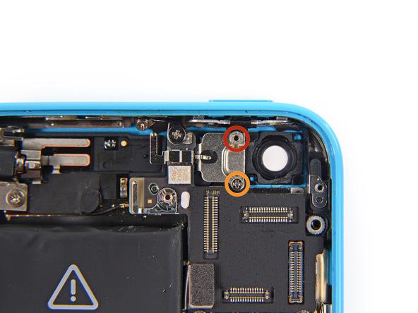 پیچ 3.0 میلیمتری و استندافی که در عکس با رنگ قرمز مشخص شده را از گوشه سمت راست و بالای قاب آیفون 5C تعمیری باز کنید.