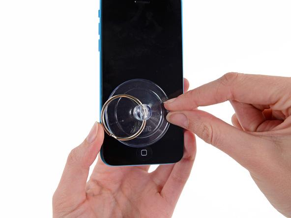 با توجه به روشی که برای باز کردن قاب آیفون 5C تعمیری از آن استفاده کردید، گوشی را از ابزارهای استفاده شده جدا کنید.
