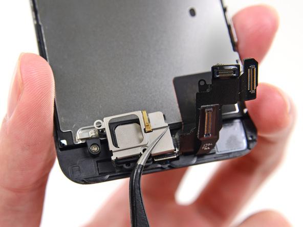براکت اسپیکر مکالمه آیفون 5S تعمیری را از روی درب پشت گوشی جدا کنید.