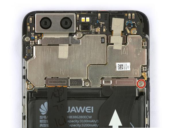 پیچی که در عکس اول با رنگ قرمز مشخص شده را با پیچ گوشتی فیلیپس #000 باز کنید. این پیچ نگهدارنده براکت روی کانکتور باتری گوشی است.
