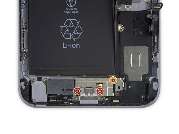 پیچ 3.5 میلیمتری براکت موتور تپتیک که در عکس با رنگ نارنجی نمایش داده شده را باز کنید.
