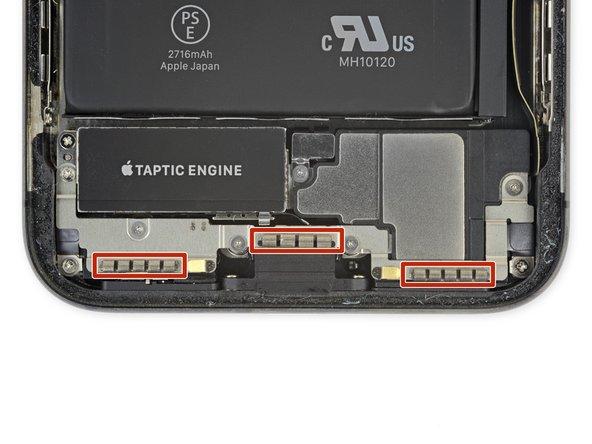باز کردن پیچ براکت های روی محفظه اسپیکر و موتور ویبره