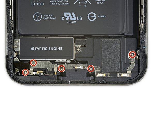 باز کردن پیچ های براکت اسپیکر و موتور ویبره